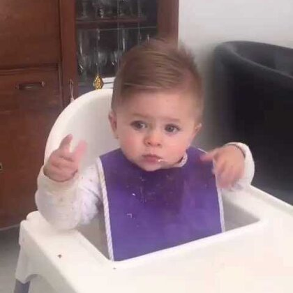 """💥temporary post 💥 LOOK AT HIS HANDS!😳Has anyone ever known a baby to do this whirly twirly thing with their hands?! Our Romeo does it ALL THE TIME!"""" (he's covered in food 😭 he's wearing a purple bib😝 he's in a pink polka dot onesie😖) #BabyRomeo##宝宝#"""